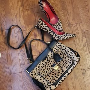 TORY BURCH cheetah Pricilla leather satchel.